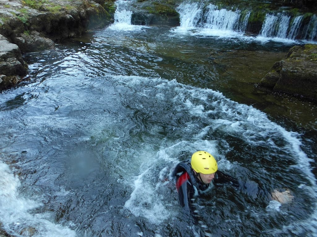 Swimming during Canyoning activity in South Wales