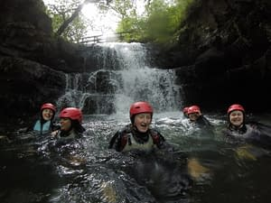 Group swimming in a plunge pool on their gorge walking activity