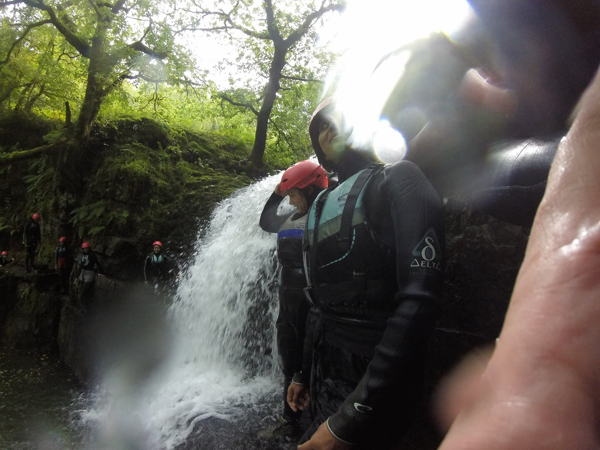 Group getting ready to jump into a plunge pool during gorge walking activity