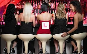 Bride to be sat with her Hens on her Hen Party in Swansea