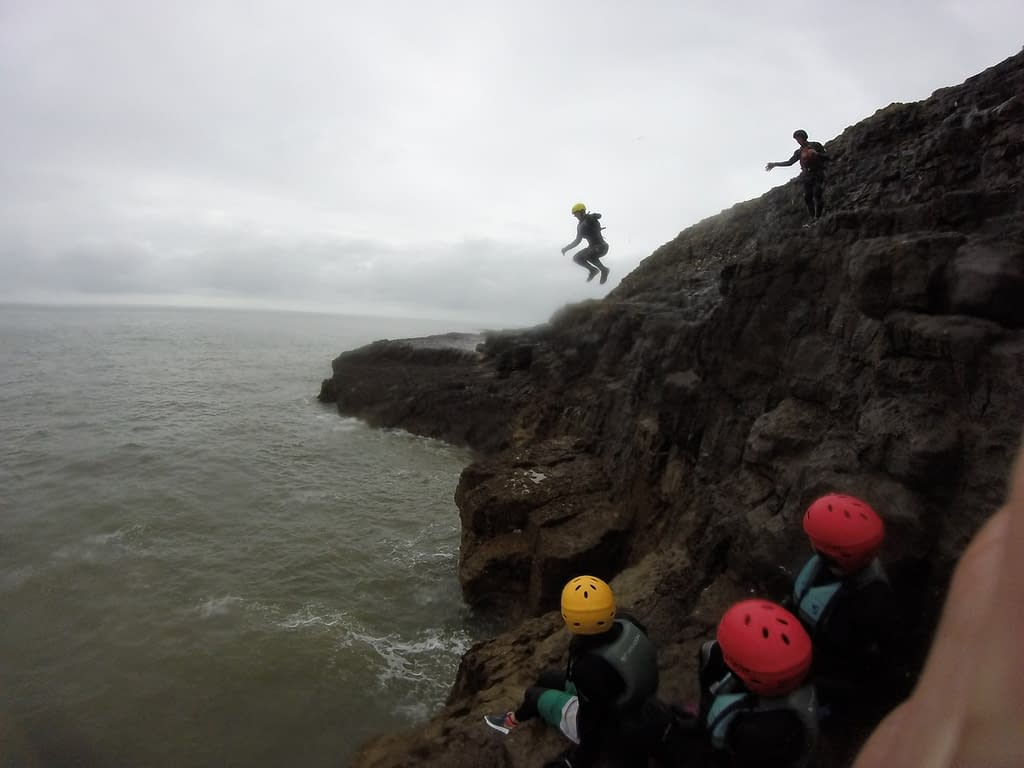 Group taking part in coasteering activity in South Wales