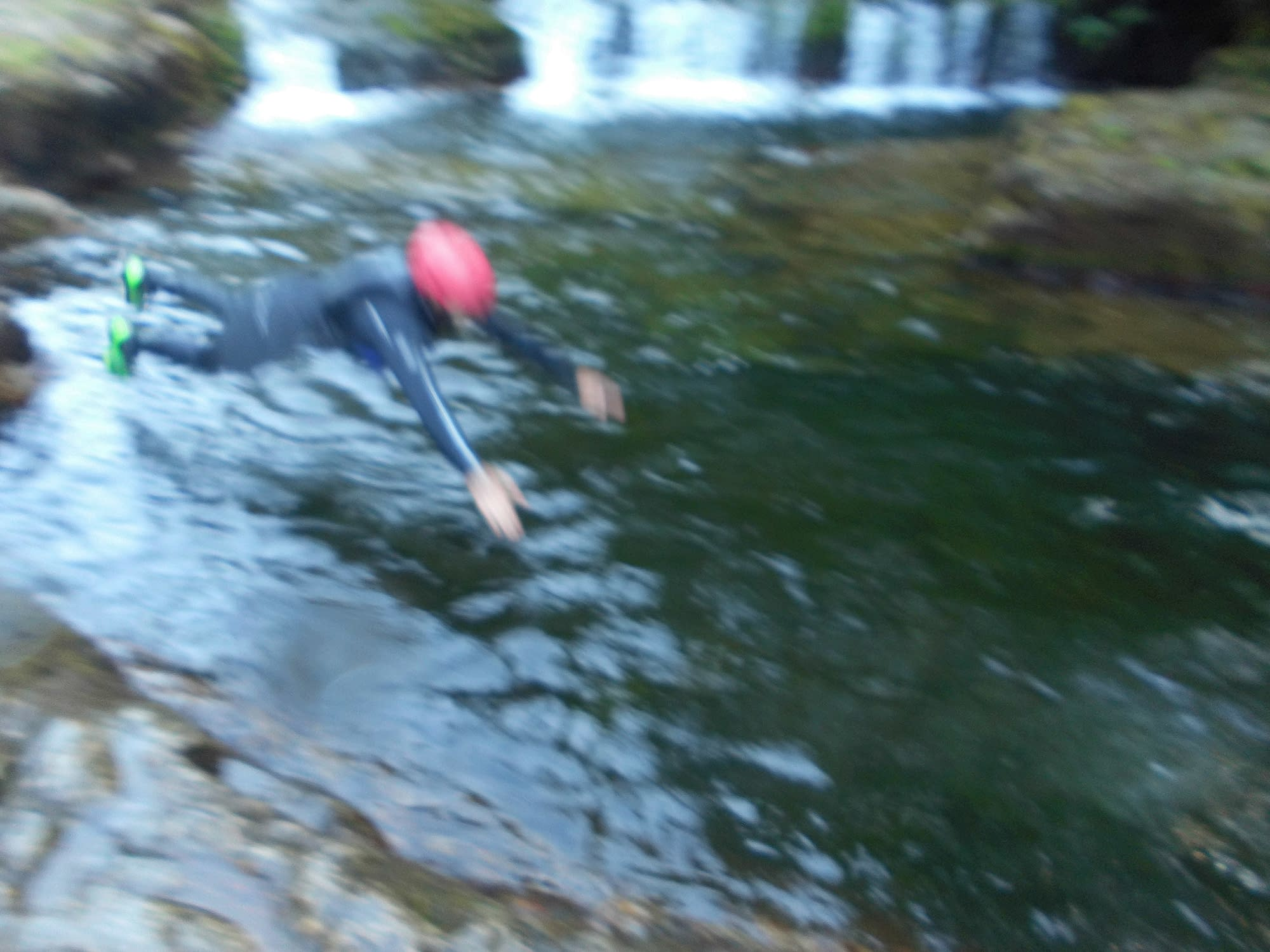 Jumping into the river to start canyoning with wild swimming