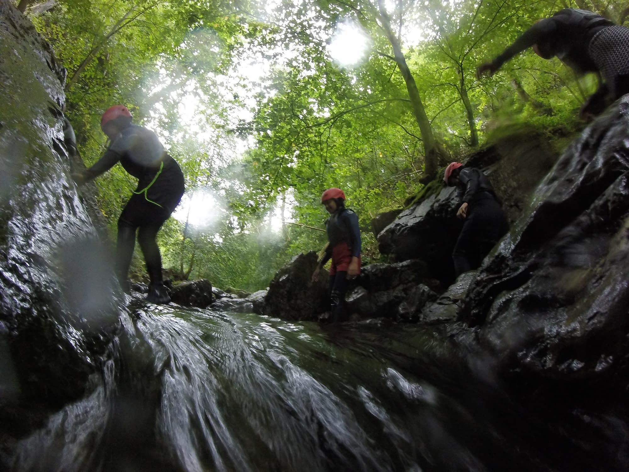 Scrambling across a waterfall in South Wales