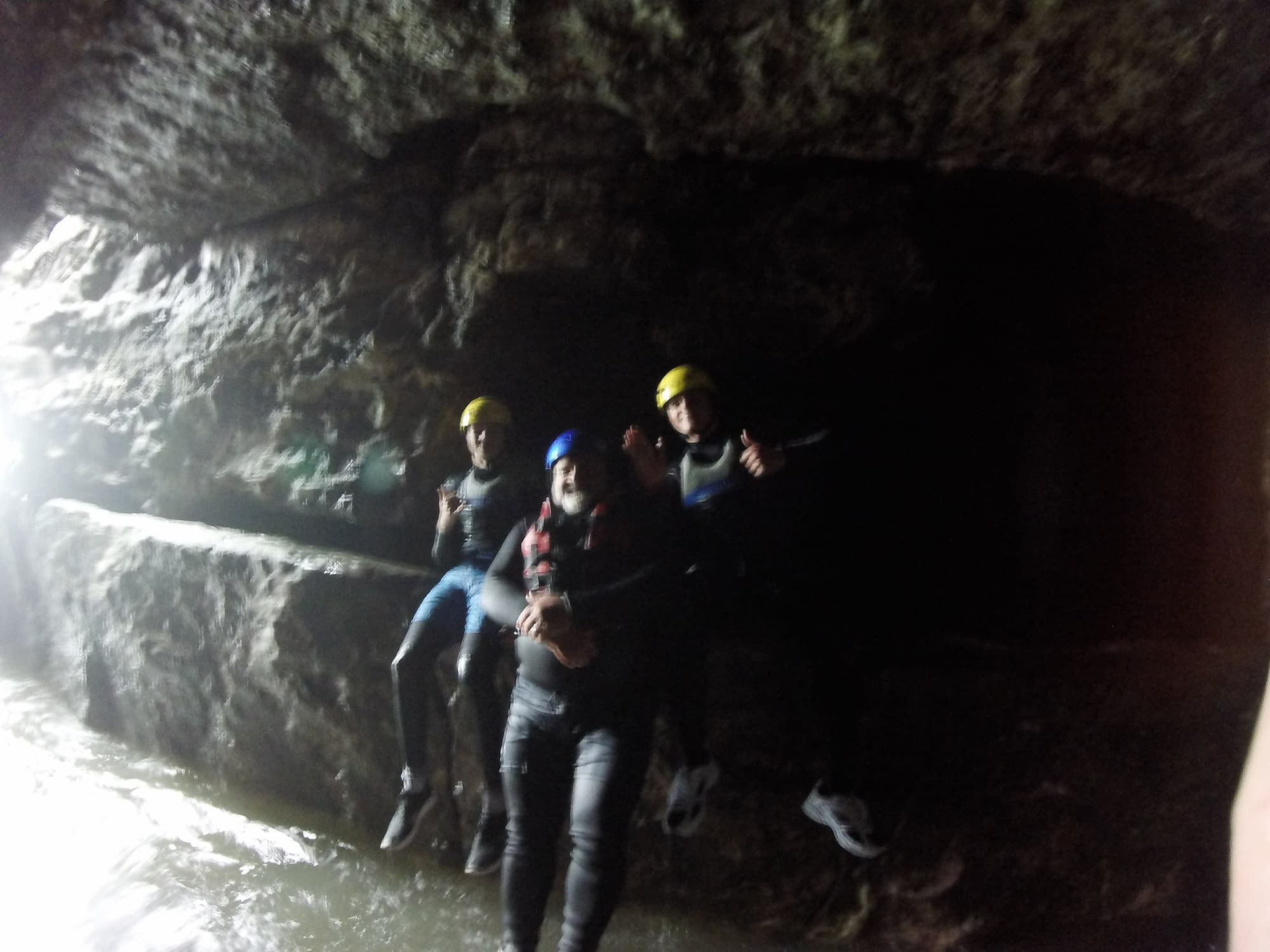 Group exploring the caves whilst coasteering