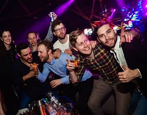 Group of lads in a nightclub during a stag party in Porthcawl